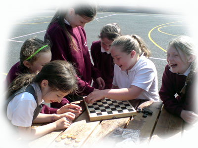 The children enjoy playing chess and draughts.