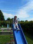Evan having fun on the slide.