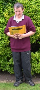 Martin with certificate recognising a full attendance record throughout his time in school.