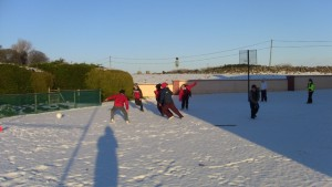 Playing soccer in the snow.