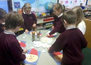 We glued on Santa's red hat and stuck on his white beard using cotton wool.