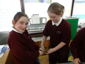 Grace and Marie making a cross
