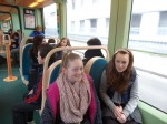 On the tram to our partner school in Hoenheim, Strasbourg - Rebecca and Amy with Justin in the background.