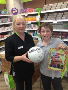 Me receiving my prize from Connie, Lloyd's Pharmacy, Claremorris.