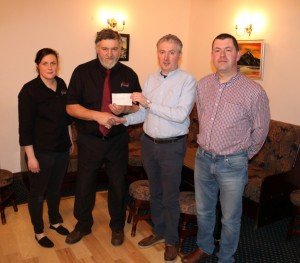 Breda Jordan and Tom Kelly of Foxhall presenting principal, Mr. O Beirn and chairperson of the committee, PJ Commins with a cheque of €1,000.